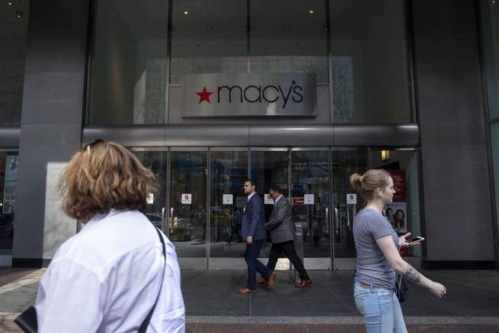 People pass Macy's along North Michigan Avenue near Water Tower Place on May 8, 2018, in Chicago.